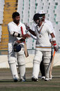Karan Goel and Mandeep Singh walk off after securing victory, Punjab v Saurashtra, Ranji Trophy, Group A, Mohali, 3rd day, November 26, 2012