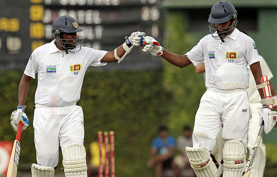 Thilan Samaraweera and Suraj Randiv punch gloves during their stand