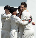 Trent Boult is congratulated by his team-mates