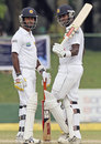 Angelo Mathews acknowledges his fifty as Nuwan Kulasekara looks on