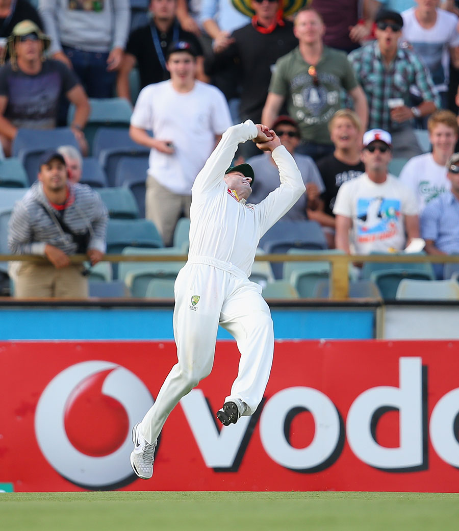 Michael Hussey leaps backward to catch Vernon Philander