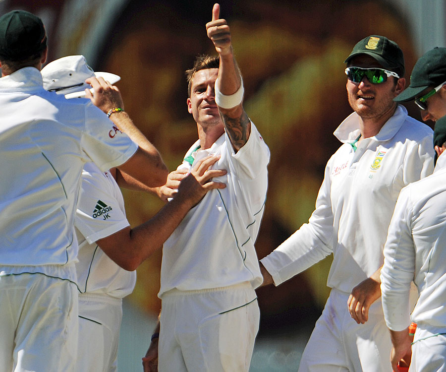 Dale Steyn gestures after claiming Michael Hussey's wicket