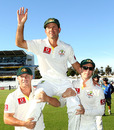 Ricky Ponting is carried by David Warner and Michael Clarke after the Perth Test