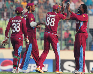 Chris Gayle and his team-mates celebrate a wicket, Bangladesh v West Indies, 3rd ODI, Mirpur, December 5, 2012