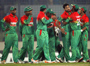 Mashrafe Mortaza is greeted by his team-mates after he dismissed Chris Gayle cheaply, Bangladesh v West Indies, 3rd ODI, Mirpur, December 5, 2012