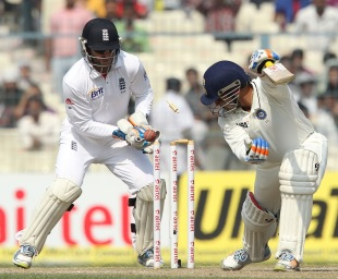 Virender Sehwag looks back at the shattered stumps, India v England, 3rd Test, Kolkata, 4th day, December 8, 2012
