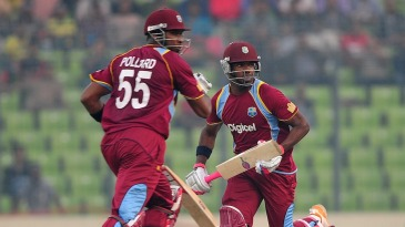 Kieron Pollard and Darren Bravo run between the wickets