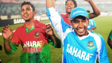 Mushfiqur Rahim takes the trophy on a lap of the ground