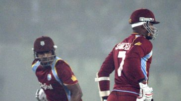 Marlon Samuels and Darren Bravo run between the wickets