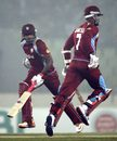 Marlon Samuels and Darren Bravo run between the wickets