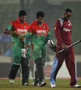 Marlon Samuels, Tamim Iqbal and Mahmudullah walk off the field