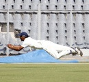 Sandeep Sharma dives full length to complete a catch