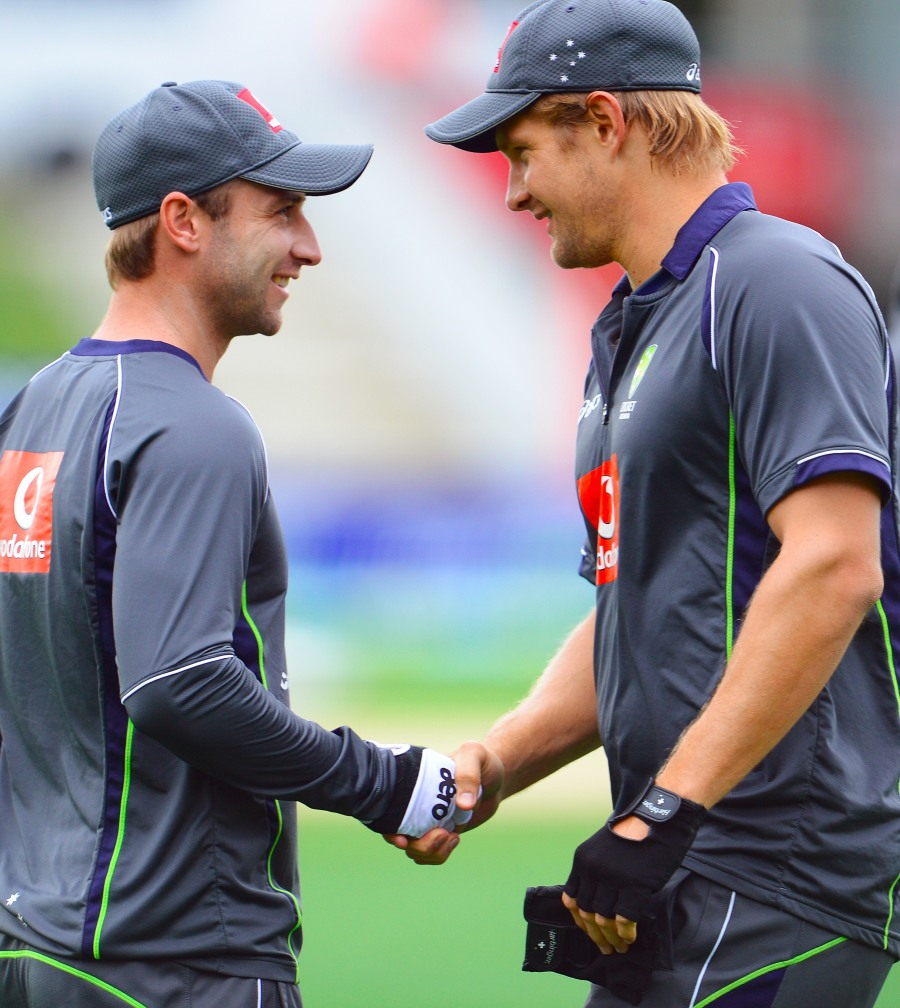 Phillip Hughes and Shane Watson shake hands at training