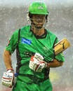 Rob Quiney protects his bat as he runs through heavy rain, Perth Scorchers v Melbourne Stars, Big Bash League, Perth, December 12, 2012
