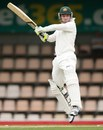 Hughes shines on steady day for Australia