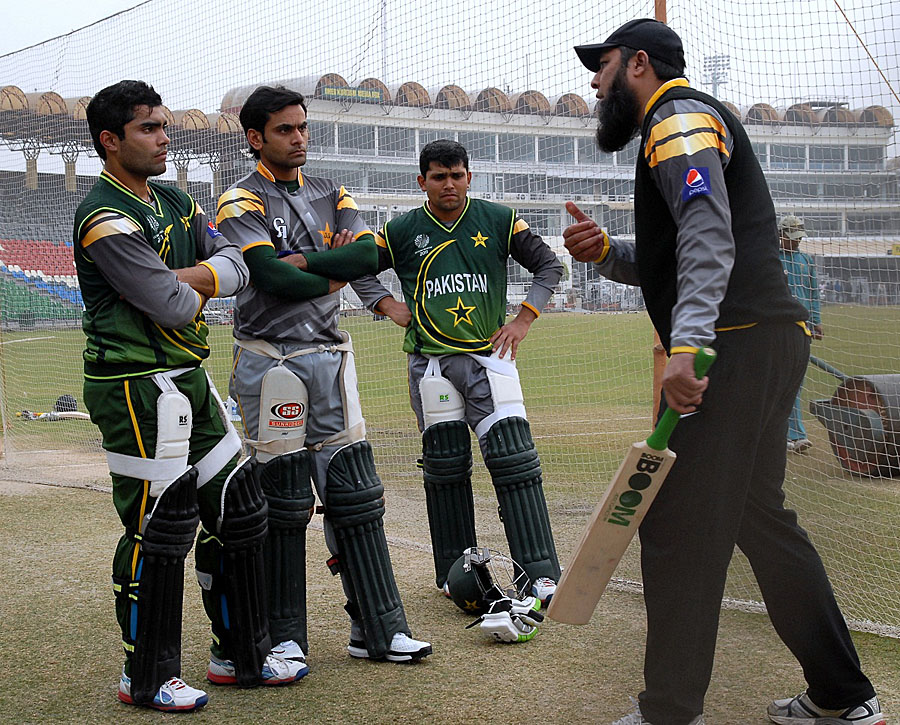 New batting consultant Inzamam-ul-Haq guides Pakistan team members in a training camp