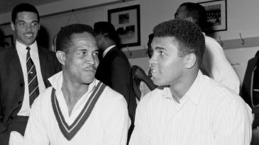 Garry Sobers sits with Muhammad Ali in the dressing room
