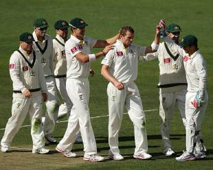 Peter Siddle is congratulated by his team-mates for his five-wicket haul, Australia v Sri Lanka, 1st Test, Hobart, 3rd day, December 16, 2012