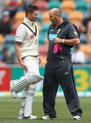 Michael Clarke speaks to physio Alex Kountouris about his injured right hamstring, Australia v Sri Lanka, 1st Test, Hobart, 4th day, December 17, 2012