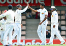 Chanaka Welegedara is congratulated for taking a wicket