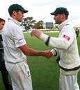 Michael Clarke congratulates Peter Siddle after the win