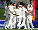 The Australian team crowds Mitchell Starc after he picked up the last wicket, Australia v Sri Lanka, 1st Test, Hobart, 5th day, December 18, 2012