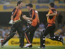 Nathan Coulter-Nile celebrates the nine-wicket win with Michael Beer and Marcus Stoinis, Brisbane Heat v Perth Scorchers, Big Bash League, December 18, 2012
