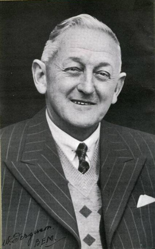 Australian scorer and baggage master Bill Ferguson after he was awarded the British Empire medal, 1957