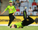 Chris Rogers tumbles onto the ground after missing a catch