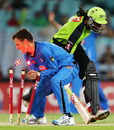 Johan Botha loses the ball in his attempt to run out Chris Gayle, Sydney Thunder v Adelaide Strikers, Big Bash League, December 20, 2012