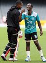 Marlon Samuels and Kemar Roach share a laugh