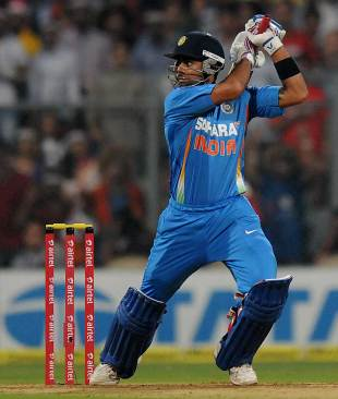 Virat Kohli slashes one during his 38, India v England, 2nd Twenty20 international, Mumbai, December 22, 2012