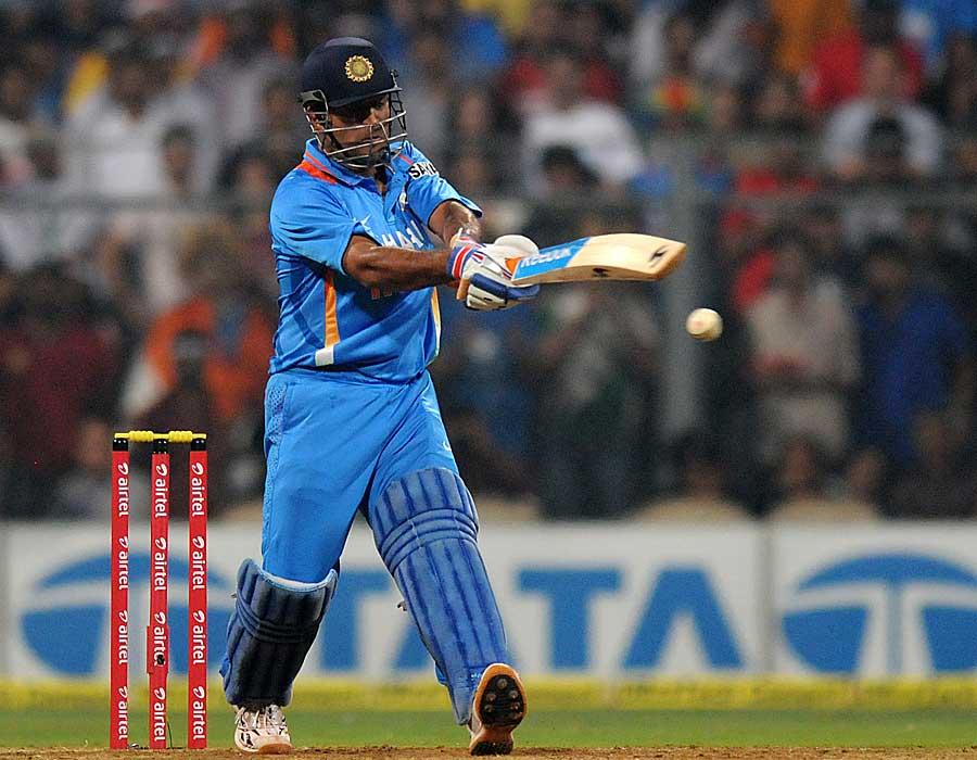 MS Dhoni swings his arms