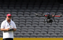The crew member operates the coptercam, Melbourne Renegades v Brisbane Heat, Big Bash League, Docklands Stadium, Melbourne, December 22, 2012