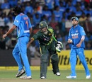 Ishant Sharma gets a friendly pat from Mohammad Hafeez, India v Pakistan, 1st T20, Bangalore, December 25, 2012