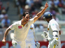 Mitchell Johnson sends back Prasanna Jayawardene, Australia v Sri Lanka, 2nd Test, Melbourne, 1st day, December 26, 2012