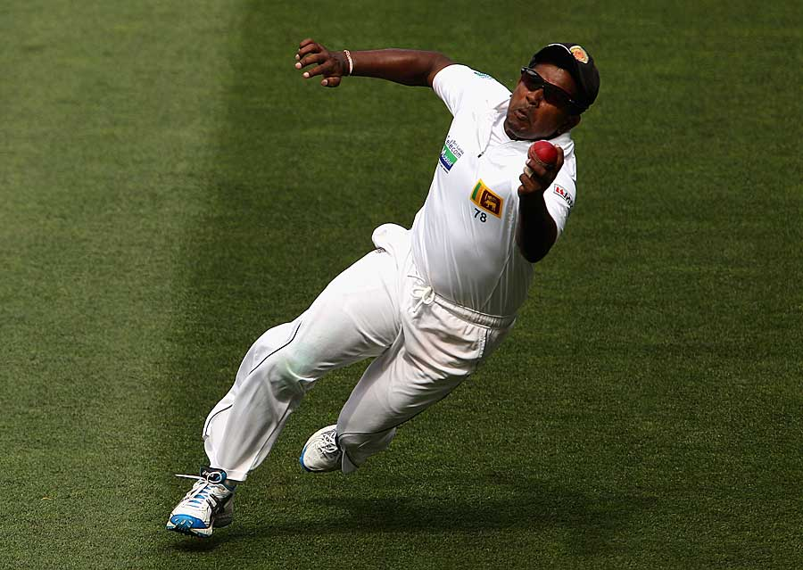 Rangana Herath dives and snaps one one-handed