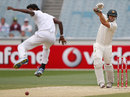 Shaminda Eranga gets out of the way of a powerful Mitchell Johnson straight drive