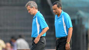 Umpires Billy Bowden and S Ravi inspect the conditions