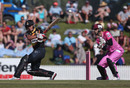 Luke Ronchi pulls as James Foster looks on