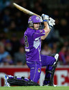 Tim Paine drives through the off side