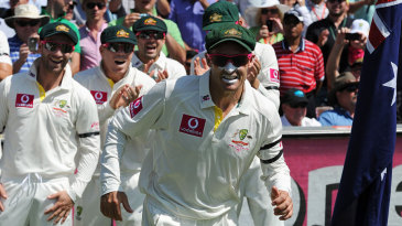 Michael Hussey leads Australia out in his final Test