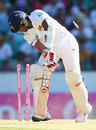 Dinesh Chandimal is cleaned up by a Mitchell Starc yorker