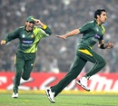 Umar Gul takes off after picking up the wicket of Virender Sehwag