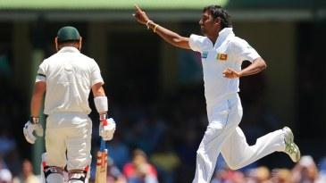 Suranga Lakmal celebrates the wicket of David Warner