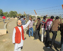 A spectator wearing a Narendra Modi mask, Rajkot, January 6, 2013