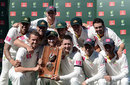 The Australians pose with the series trophy after beating Sri Lanka by five wickets