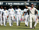 Michael Hussey acknowledges the cheers after his final Test appearance