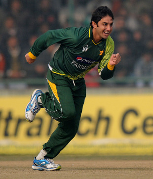 Saeed Ajmal sets off for a run after dismissing Suresh Raina, India v Pakistan, 3rd ODI, Delhi, January 6, 2013