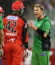 A miked-up Shane Warne remonstrates with Marlon Samuels